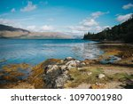 view of a lake in scottish... | Shutterstock . vector #1097001980