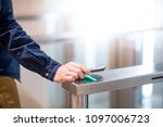 male hand using smartphone to... | Shutterstock . vector #1097006723