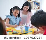 close up teacher and the littel ... | Shutterstock . vector #1097027294