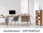 grey chair at desk with... | Shutterstock . vector #1097030510
