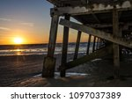 sunset beside pier  | Shutterstock . vector #1097037389