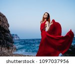 passionate woman in a red dress ... | Shutterstock . vector #1097037956