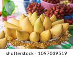 thai mango on a fruit platter | Shutterstock . vector #1097039519