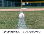 baseball on foul line | Shutterstock . vector #1097060990