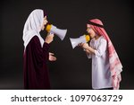 arab mother and little son in... | Shutterstock . vector #1097063729