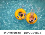 Yellow Pool Floats In A...