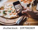taking photo of pizza dinner... | Shutterstock . vector #1097082809