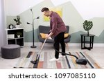 young man removing dirt from... | Shutterstock . vector #1097085110