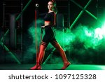 young woman in the gym with a... | Shutterstock . vector #1097125328