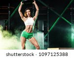 young woman in the gym with a... | Shutterstock . vector #1097125388