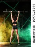 young woman in the gym with a... | Shutterstock . vector #1097125394