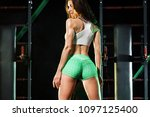 young woman in the gym with a... | Shutterstock . vector #1097125400