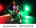 young woman in the gym with a... | Shutterstock . vector #1097125478