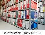 stacks of files and paperwork... | Shutterstock . vector #1097131133