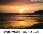 warm sunset over the pacific... | Shutterstock . vector #1097158628