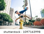 parkour man doing tricks on the ... | Shutterstock . vector #1097163998