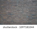 Small photo of Rough fade brick wall texture