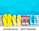 Flip flops on stone background on poolside. Summer family vacation concept