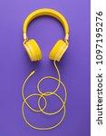 yellow headphones on purple... | Shutterstock . vector #1097195276