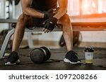 muscular man at gym taking a... | Shutterstock . vector #1097208266