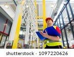 factory supervisor in yellow... | Shutterstock . vector #1097220626