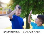 happy young little brothers... | Shutterstock . vector #1097257784