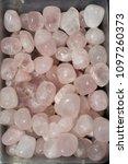 tumbled rose quartz gem stone... | Shutterstock . vector #1097260373