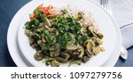 red rice with mushrooms and... | Shutterstock . vector #1097279756