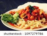 ribbon pasta with arrabiata... | Shutterstock . vector #1097279786