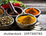 spices on wooden bowl background | Shutterstock . vector #1097300783