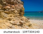 rocky coast. beach in greece.... | Shutterstock . vector #1097304140