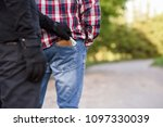 the thief in black clothes and... | Shutterstock . vector #1097330039