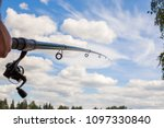 fishing rod on a blue sky... | Shutterstock . vector #1097330840