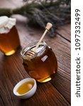 honey in jar with honey dipper... | Shutterstock . vector #1097332499