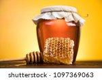jar full of fresh honey and... | Shutterstock . vector #1097369063