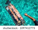 souvla over mediterranean sea.... | Shutterstock . vector #1097412773