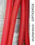 red corrugated curvilinear... | Shutterstock . vector #1097424026