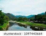 beautiful green forest  river... | Shutterstock . vector #1097443664