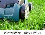 scarifier on green grass. work... | Shutterstock . vector #1097449124