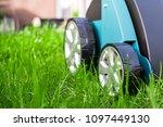 scarifier on green grass. work... | Shutterstock . vector #1097449130