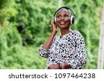 cheerful woman listens to music ...   Shutterstock . vector #1097464238