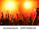 concert crowd at rock concert | Shutterstock . vector #1097468618
