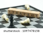 wood word placed on chessboard... | Shutterstock . vector #1097478158