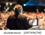 female speaker giving a talk on ... | Shutterstock . vector #1097496740