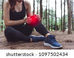 sport woman injury at knee...   Shutterstock . vector #1097502434
