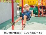 funny kid boy having fun with... | Shutterstock . vector #1097507453