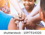 children and parent holding... | Shutterstock . vector #1097514320