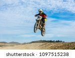 racer on a motorcycle in flight ... | Shutterstock . vector #1097515238