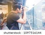 asian handsome guy taking...   Shutterstock . vector #1097516144
