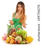 Young woman with assorted fruits in wicker basket isolated on white - stock photo